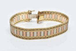 A 9CT TRI-COLOURED GOLD WIDE FLAT LINK BRACELET, designed with textured yellow, rose and white