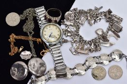 A SILVER JEWELLERY COLLECTION, to include a silver charm bracelet, three pence coin bracelet, a