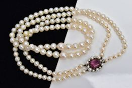 A CULTURED PEARL NECKLACE, designed with two strands of graduated cultured pearls, measuring