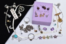 A SELECTION JEWELLERY, to include a pair of stud earrings, each designed with a claw set oval cut