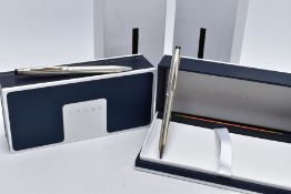 TWO CASED 'CROSS' BALL POINT PENS, each of an engine turn design, stamped 'Cross 925' silver cap/