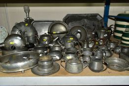A COLLECTION OF PEWTER WARES etc, mostly of plainished decoration, to include tea pots, milk jugs,