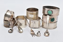 AN ASSORTEMENT OF SILVER NAPKIN RINGS AND SALT SPOONS, to include eight napkin rings of various