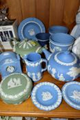 A SMALL COLLECTION OF WEDGWOOD JASPERWARE, comprising in light blue, two circular pin dishes, a