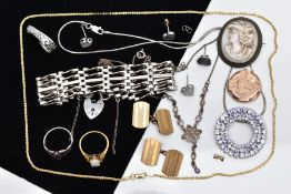 A SELECTION OF JEWELLERY, to include a silver purple cubic zirconia set openwork circular pendant,