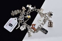 A WHITE METAL CHARM BRACELET, suspending twelve charms in forms such as a decorative enamel donkey