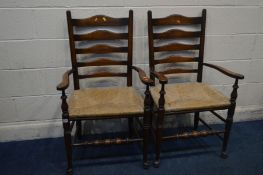 A PAIR OF 20TH CENTURY GEORGIAN STYLE ELM AND OAK LADDERBACK ELBOW CHAIRS with rush seats