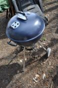 A WEBER MASTER-TOUCH BBQ with accessories and cover