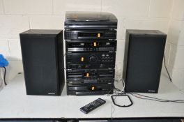 A KENWOOD COMPONANT HI FI including a DP-730 CD player, X-63 Dual Tape player, an A-63 Amplifier,