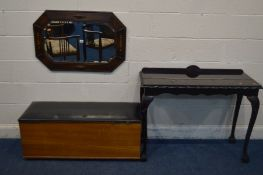 AN EARLY TO MID 20TH CENTURY OAK BEVELLED EDGE WALL MIRROR, with canted corners, 85cm x 57cm along