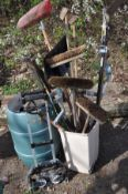 A GREEN WATER BUTT together with a folding sack truck, and a bin containing various garden tools