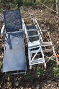 A SET OF WHITE ALUMINIUM STEP LADDERS height: 168cm, a smaller set of aluminium step ladders,