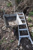 A GALVANSISED METAL WHEEL BARROW together with a set of aluminium step ladders, length 190cm (2)