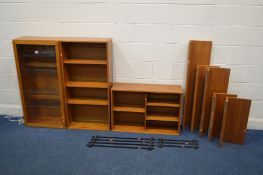 A BEAVER AND TAPLEY 33 TEAK MODULAR WALL SHELVING SYSTEM, comprising of a glazed single door display