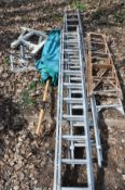 TWO SETS OF ALUMINIUM STEP LADDERS, a Youngman closed length 3.5m and extended 6.2m, another set