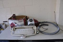 A DIRT DEVIL 1600W VACUUM CLEANER ( PAT pass and working) and a Vintage table top Mangle (SD)