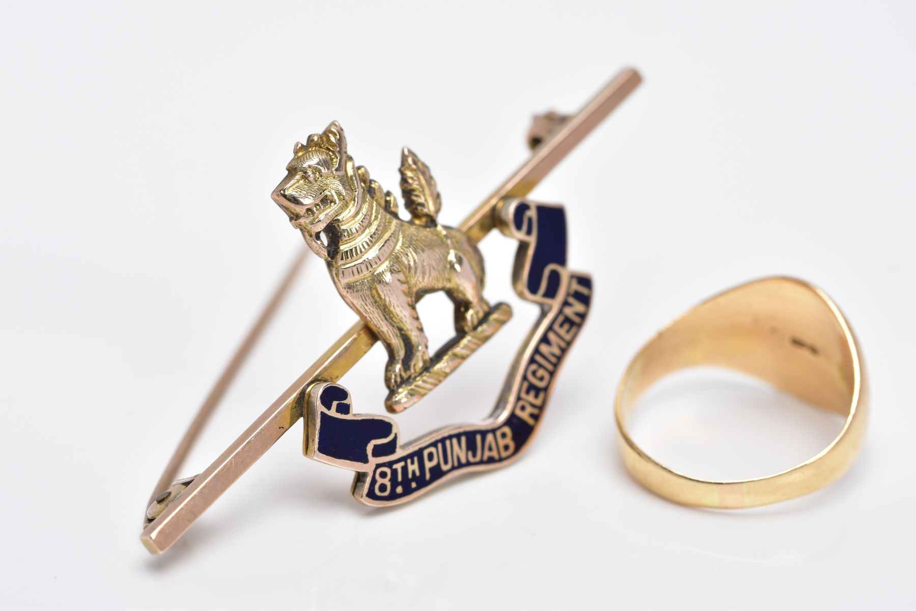 AN 18CT GOLD SIGNET RING AND A YELLOW METAL REGIMENT BADGE, oval signet ring with an engraved - Image 3 of 3