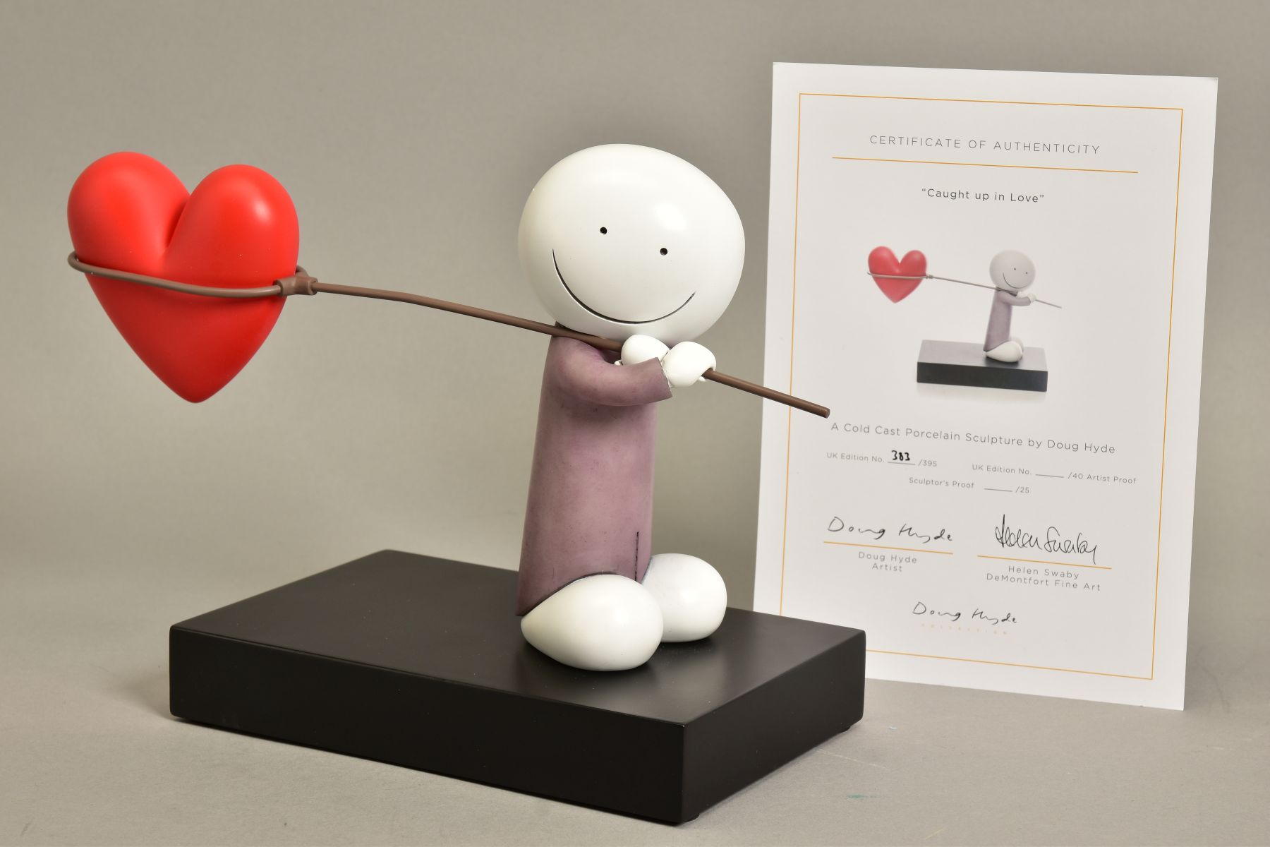DOUG HYDE (BRITISH 1972) 'CAUGHT IN LOVE', a limited edition sculpture of a figure carrying a net