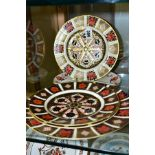 FOUR ROYAL CROWN DERBY 1128 IMARI PATTERN PLATES AND A 'BALI' PATTERN CRESCENT SHAPED PLATE,