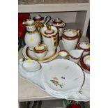 A LIMOGES PORCELAIN FISH SERVICE SET, comprising serving platter and jug and six scalloped shaped