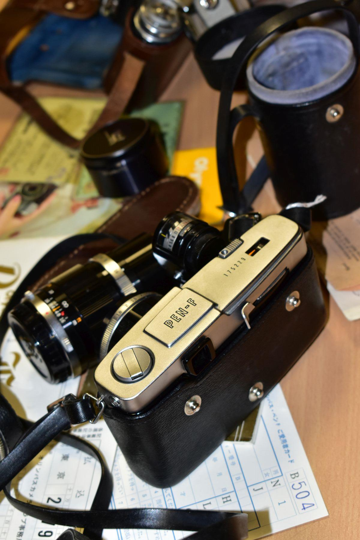 AN ORIGINAL OLYMPUS F HALF FRAME FILM CAMERA fitted with a 38mm f1.8 Olympus Zuiko lens and F T - Image 9 of 11