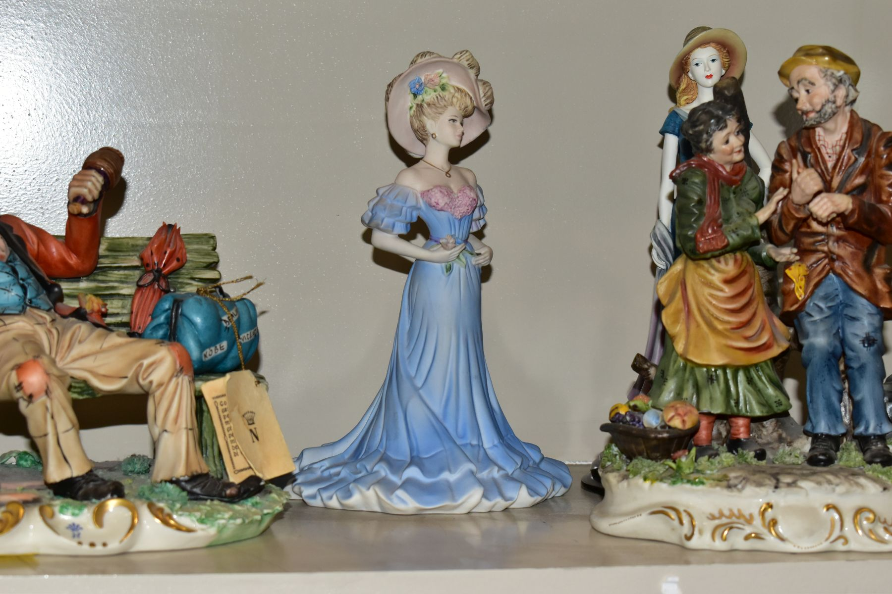 A GROUP OF CERAMIC FIGURES AND ORNAMENTS, including Capo Di Monte tramp on a bench, elderly - Image 4 of 16