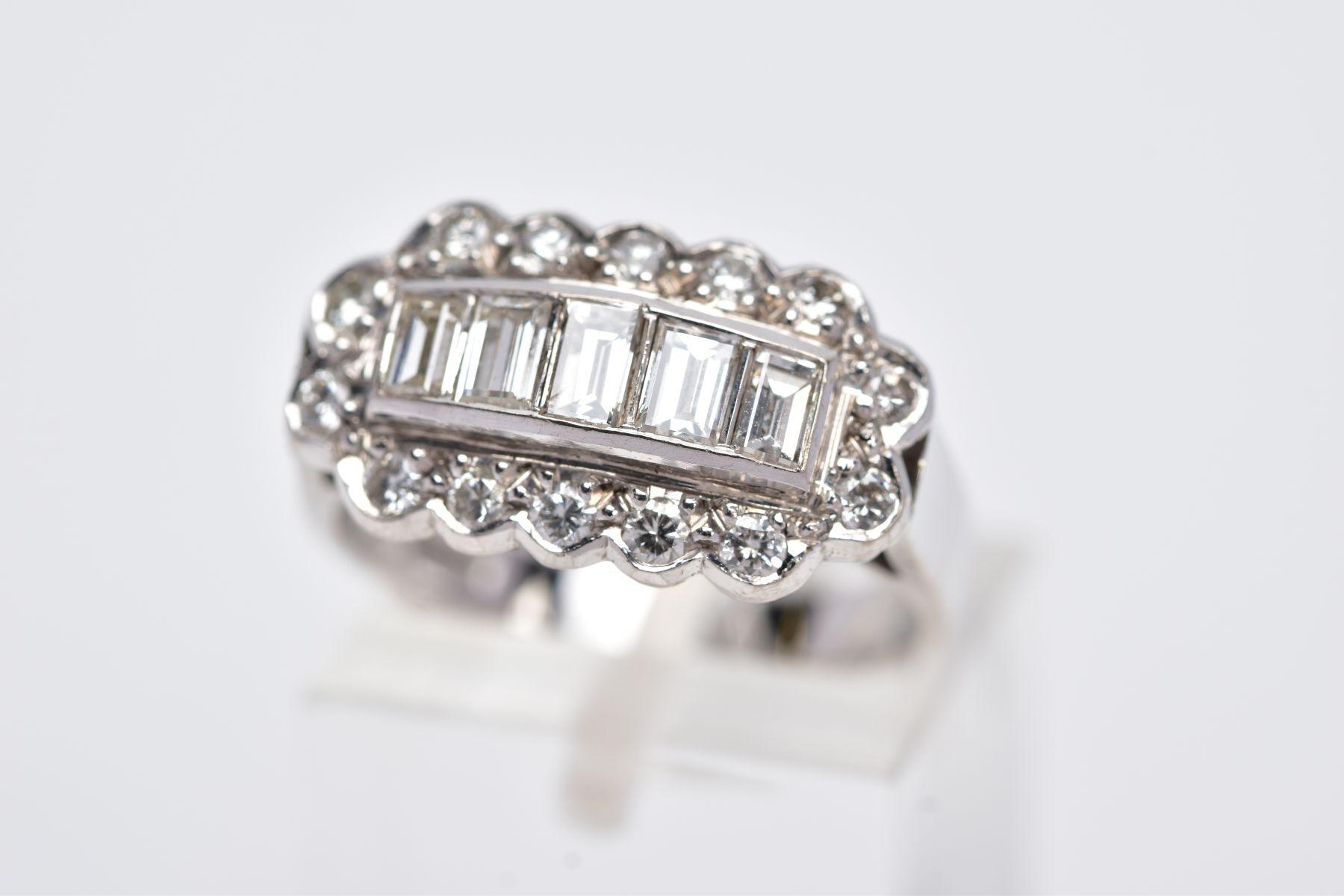 A LATE 20TH CENTURY 18CT WHITE DIAMOND DRESS RING, comprising five trap cut diamonds each