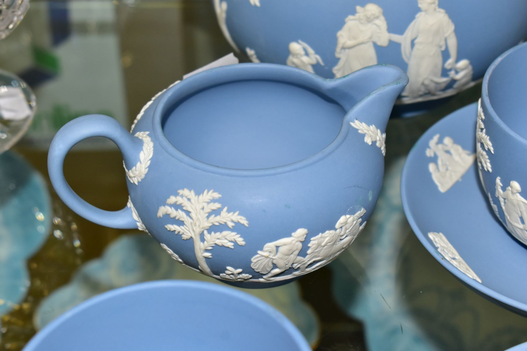 A SMALL COLLECTION OF WEDGWOOD PALE BLUE JASPERWARE, comprising a tea pot and cover and flattened - Image 4 of 6