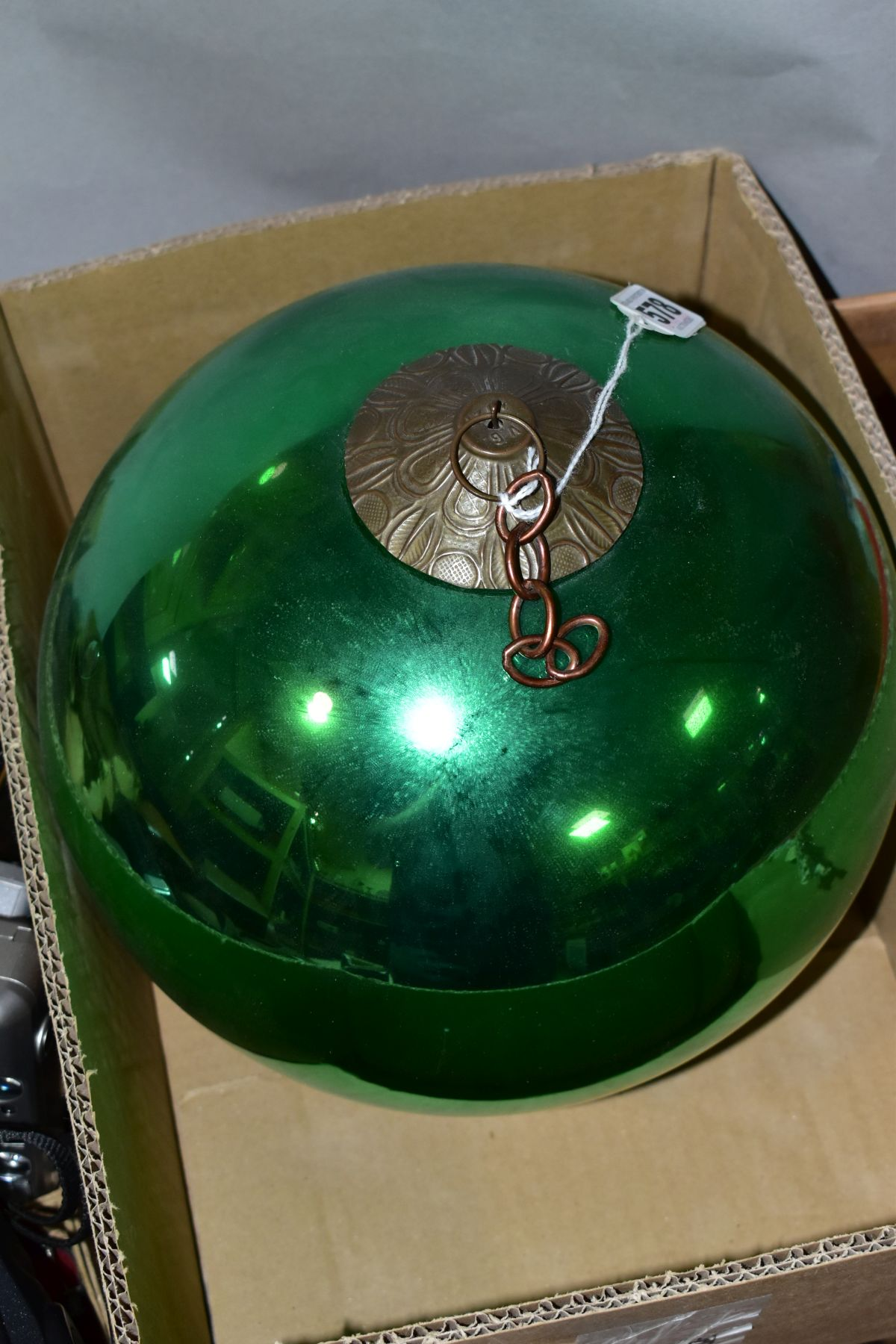 A LATE 19TH/EARLY 20TH CENTURY METALLIC GREEN GLASS WITCH'S BALL with metal mount and short length - Image 2 of 3