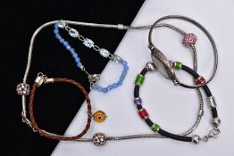 FOUR BRACELETS AND NECKLET, to include a white metal slider bracelet set with five oval cut blue