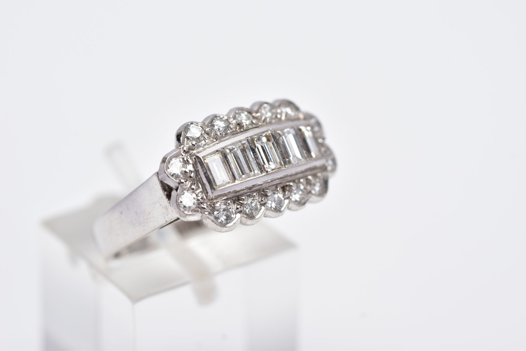 A LATE 20TH CENTURY 18CT WHITE DIAMOND DRESS RING, comprising five trap cut diamonds each - Image 4 of 5