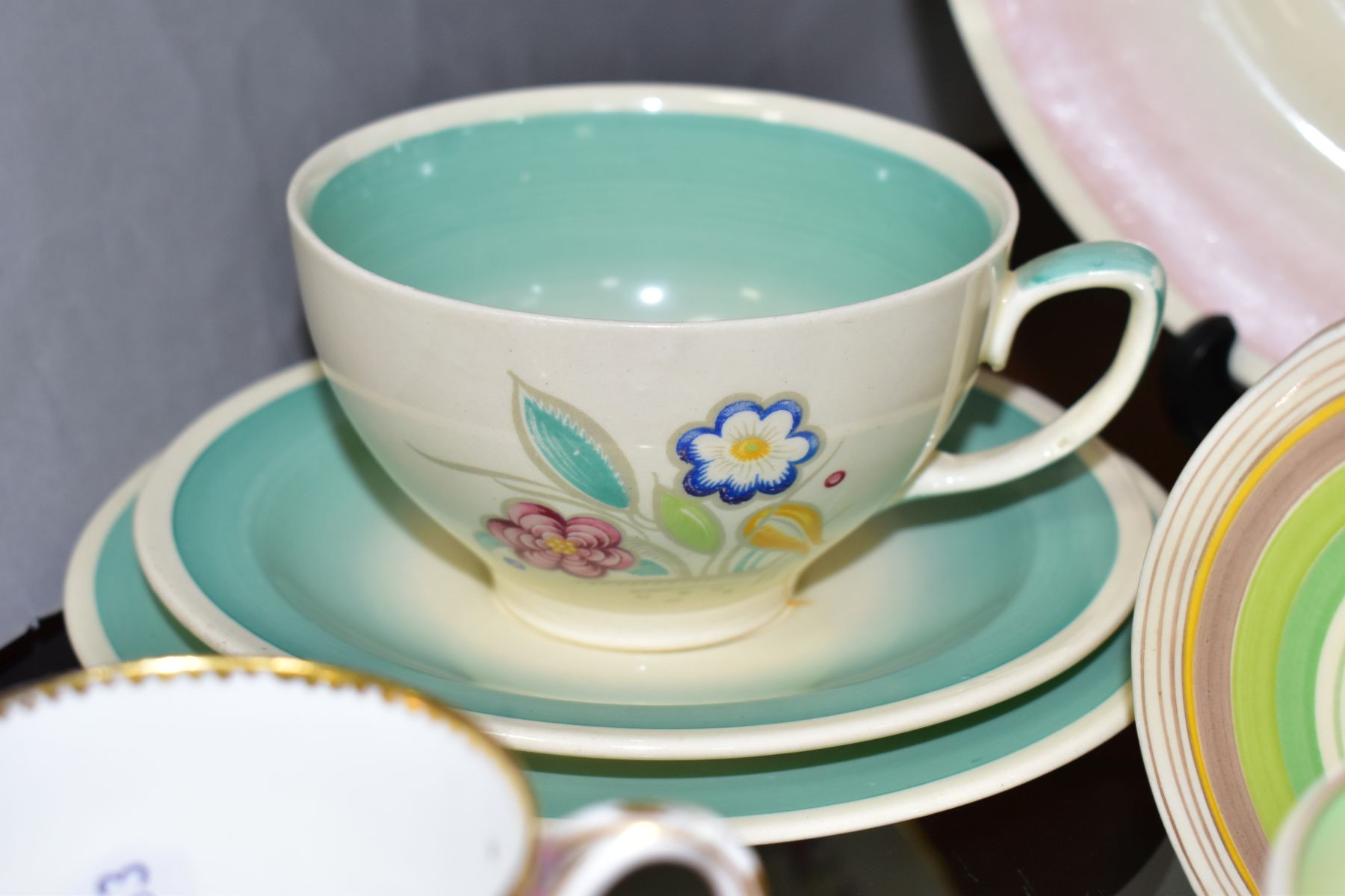 CLARICE CLIFF, comprising a Crocus pattern tea cup and saucer, backstamps for Royal Staffordshire - Image 5 of 10