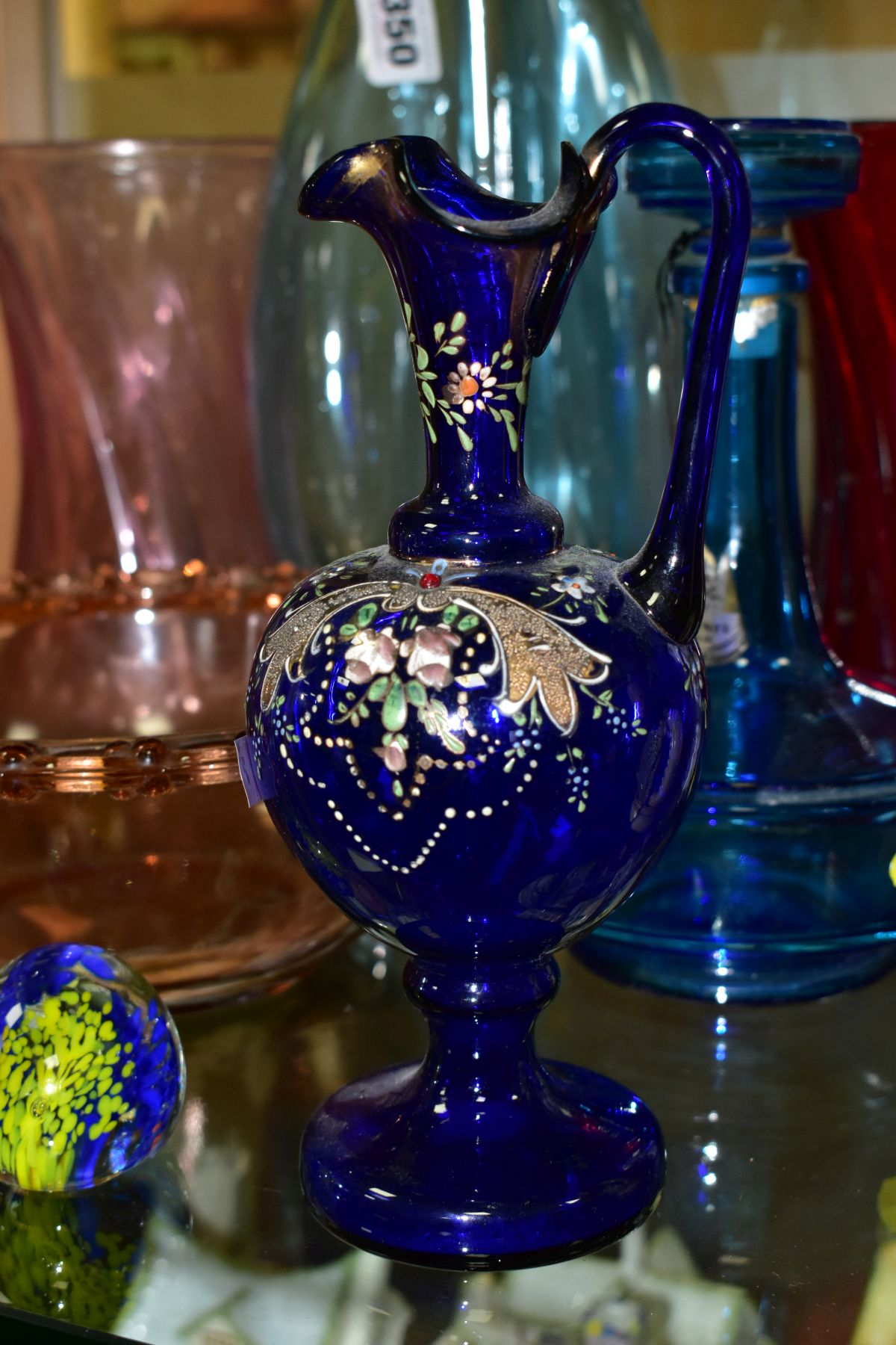 TEN PIECES OF COLOURED GLASSWARE including a blue glass vase of triform shape, with bubble - Image 9 of 10