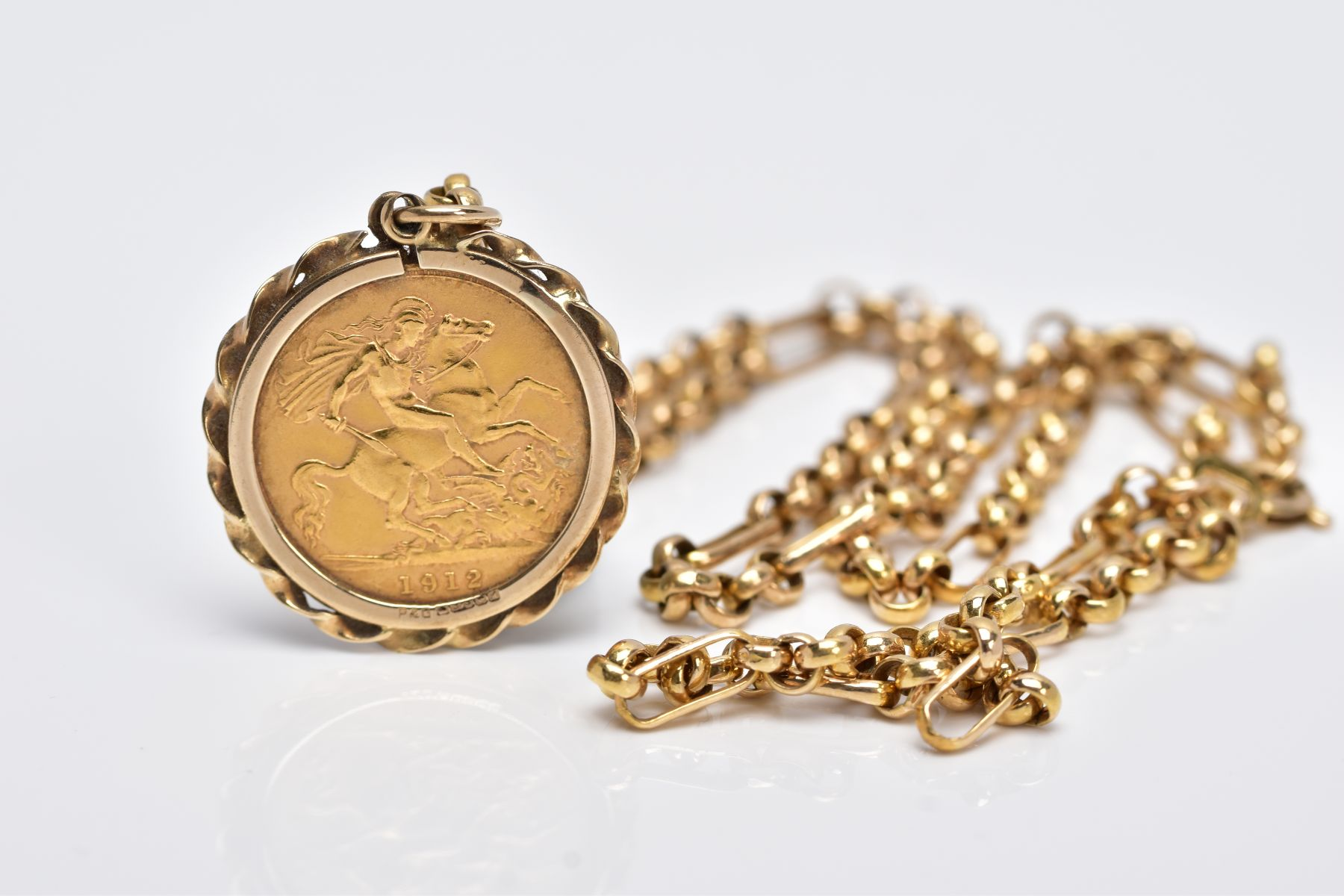 A MOUNTED GEORGIAN HALF SOVEREIGN PENDANT NECKLET, the half sovereign dated 1912, obverse