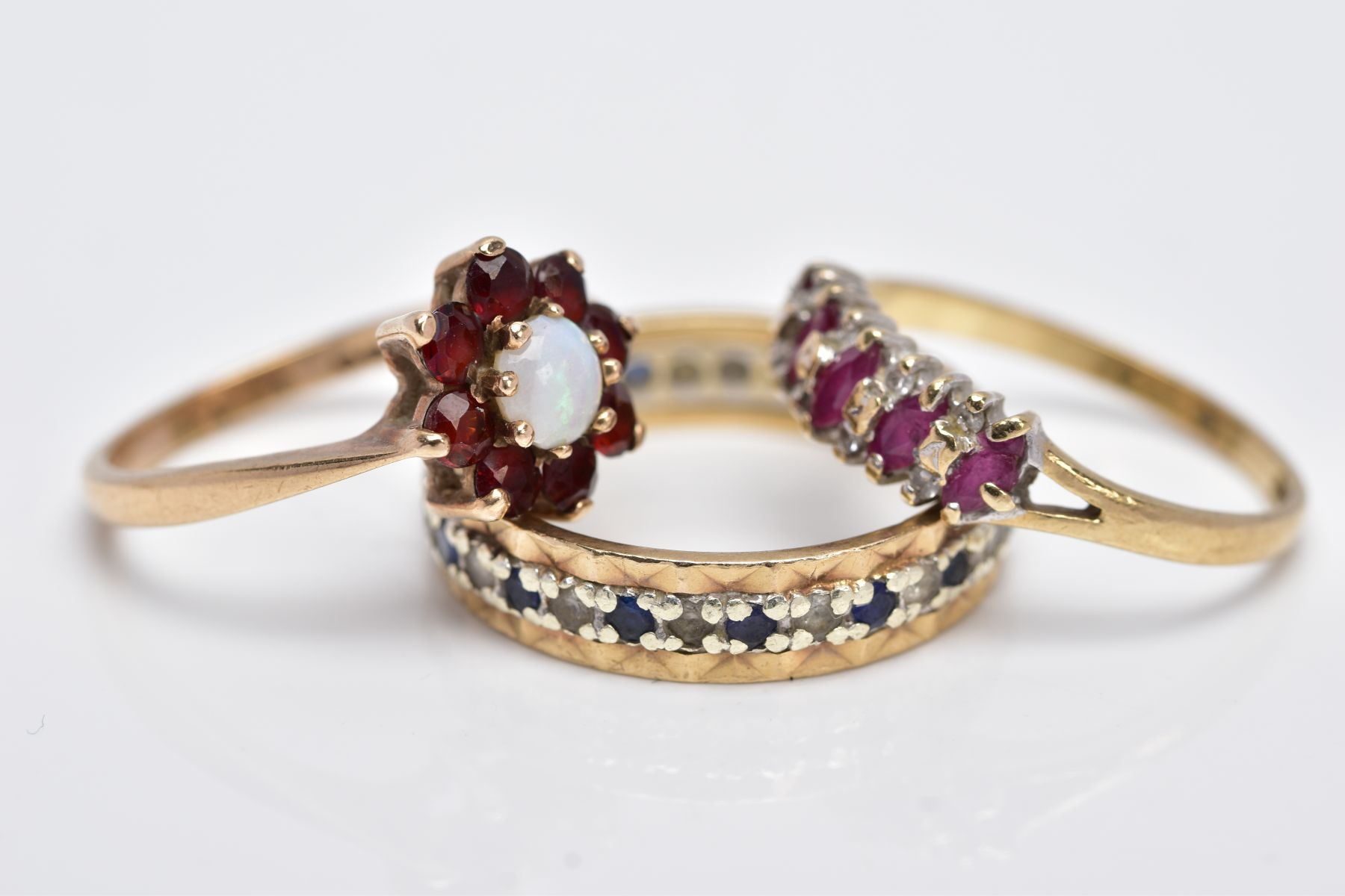 THREE 9CT GOLD GEM SET RINGS, to include a full eternity ring set with colourless spinel and blue - Image 2 of 4