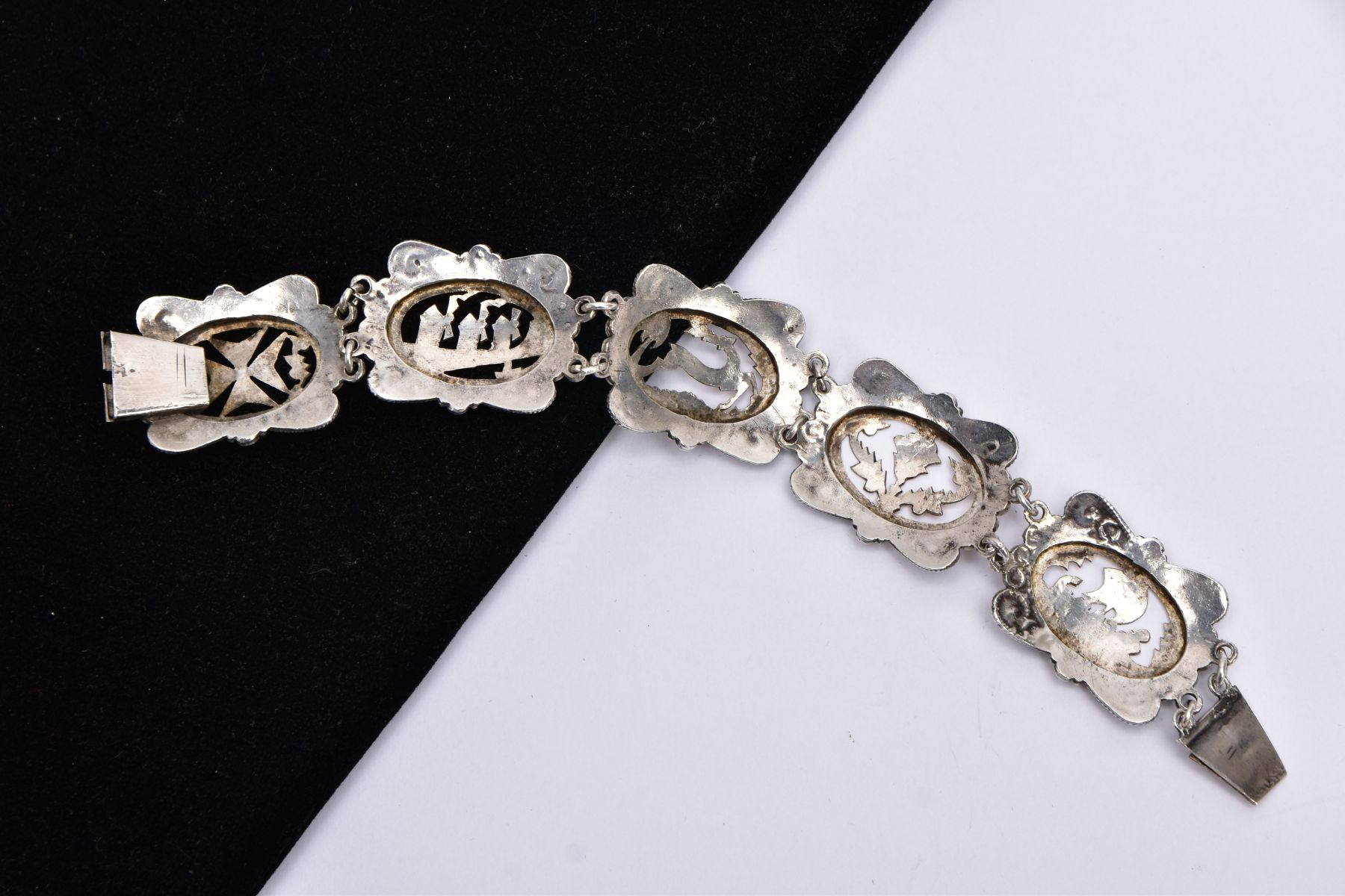 A WHITE METAL AND ROSE GOLD TONE BRACELET, designed with five openwork links, set with rose gold - Image 4 of 4