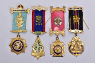 FOUR SILVER GILT, MASONIC MEDALS, of various designs decorated with blue, red, green and white