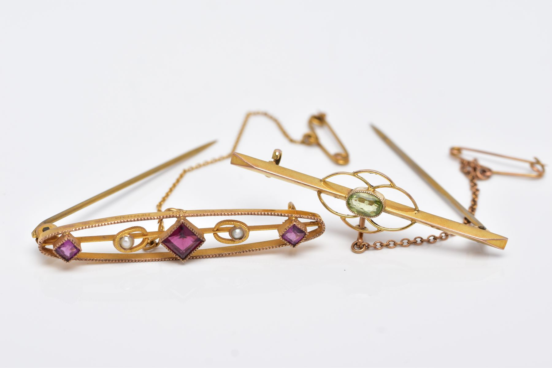 TWO EARLY 20TH CENTURY BAR BROOCHES, a 9ct gold amethyst garnet and seed pearl brooch, hallmarked