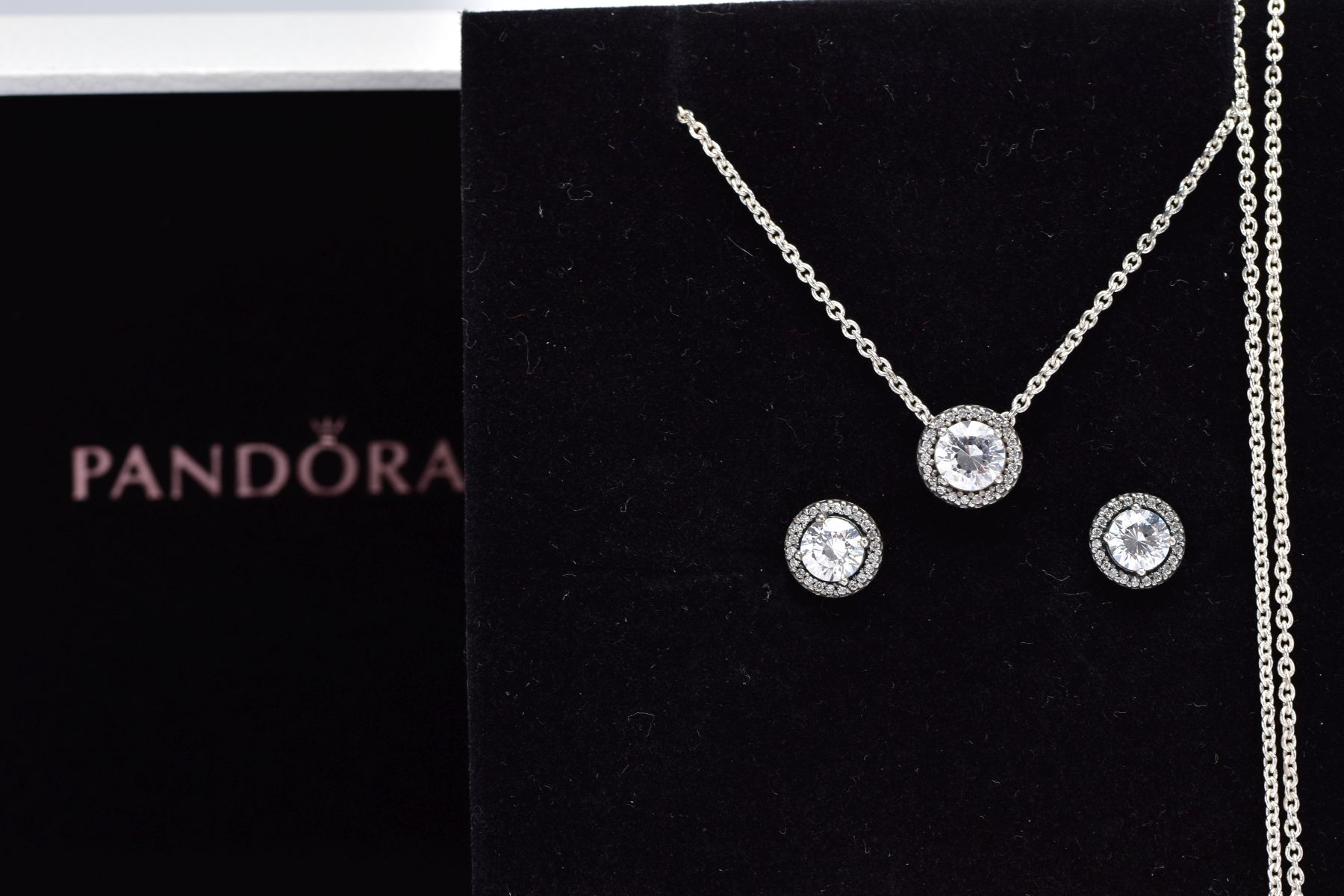 A PANDORA NECKLACE AND EARRING GIFT SET, the necklace designed with a cubic zirconia halo set