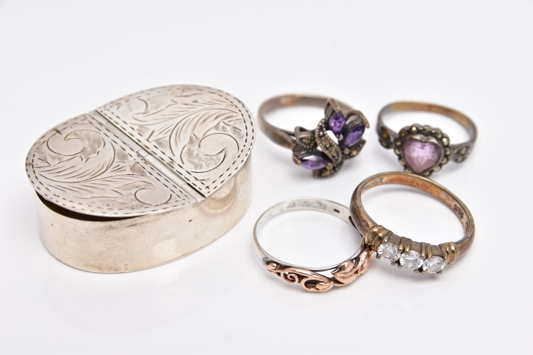 A SILVER PILL BOX, A SILVER RING AND THREE WHITE METAL RINGS, the pill box of an oval form has two - Image 3 of 4