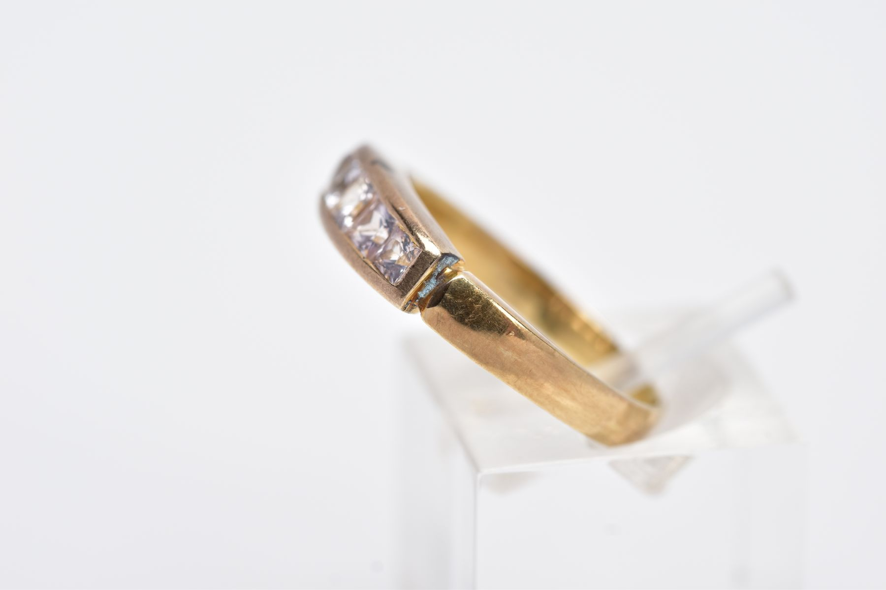 A YELLOW METAL HALF HOOP RING, designed with a row of graduated square cut colourless stones, - Image 2 of 4