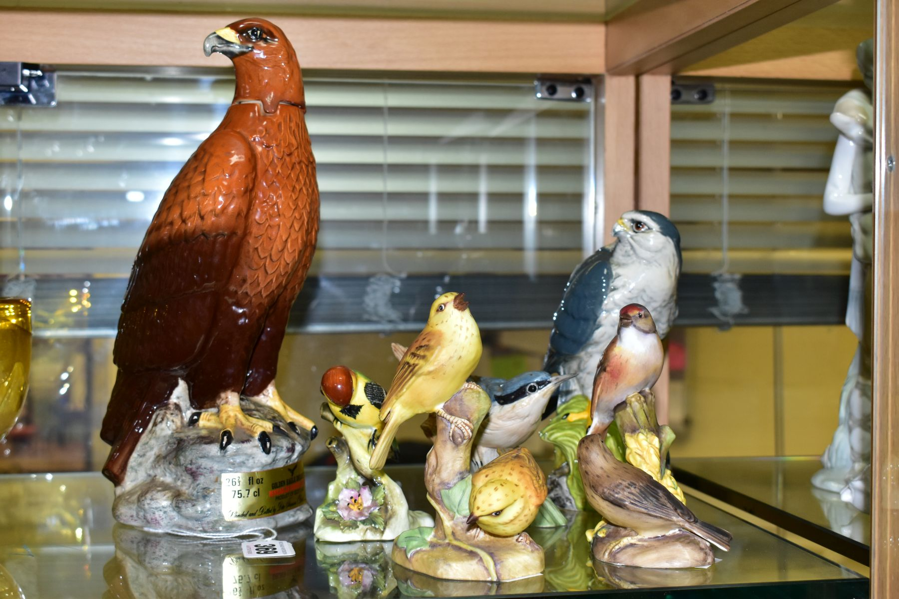 SIX VARIOUS ORNAMENTAL BIRDS, comprising a Beswick 'Golden Eagle Decanter' for Beneagles Scotch