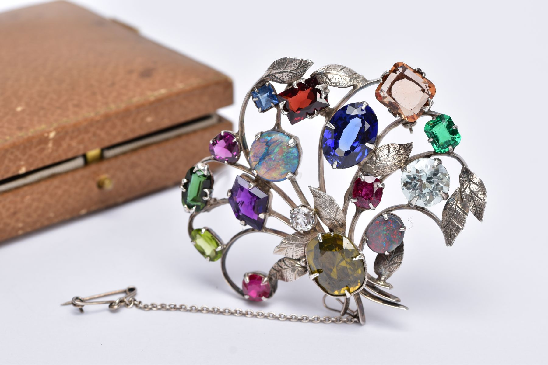A WHITE METAL FLORAL SPRAY, GEM SET BROOCH, floral spray set with a variety of multi cut gemstones - Image 2 of 5