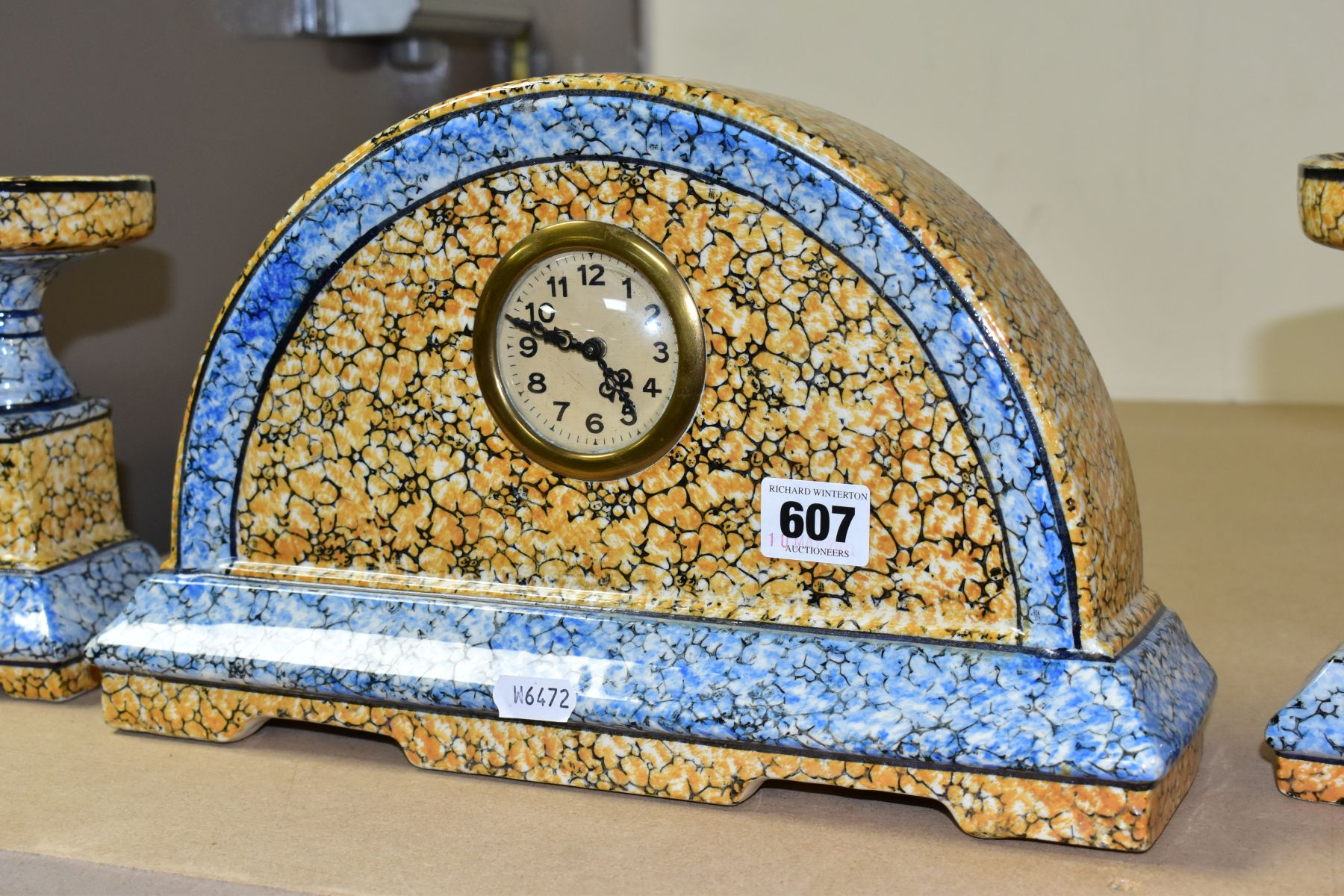 A CONTINENTAL CLOCK GARNITURE, the dome shaped porcelain clock is branded M.W inside a triangle, - Image 3 of 6