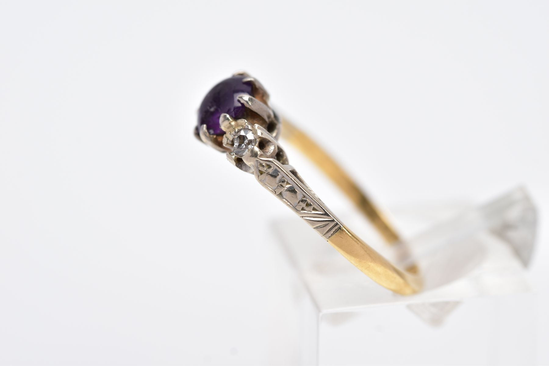 A YELLOW METAL THREE STONE RING, design with a central circular cut purple stone, assessed as paste, - Image 2 of 4