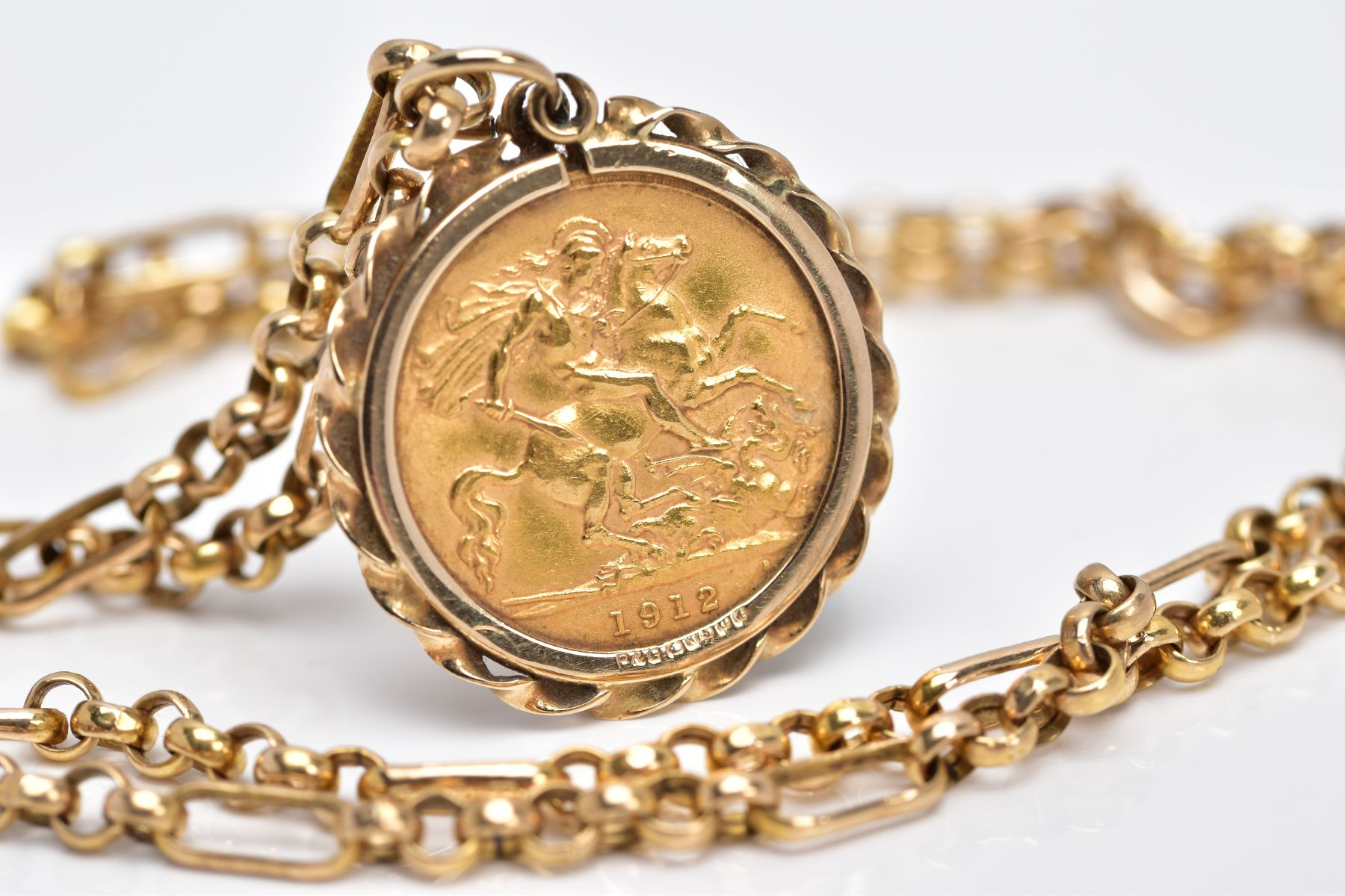 A MOUNTED GEORGIAN HALF SOVEREIGN PENDANT NECKLET, the half sovereign dated 1912, obverse - Image 3 of 3