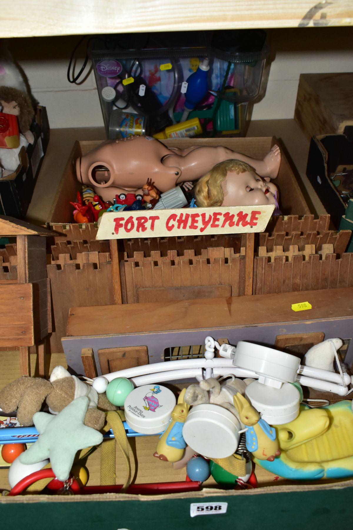 A WOODEN FORT CHEYENNE, playworn condition but appears largely complete, a B.N.D. plastic doll, with