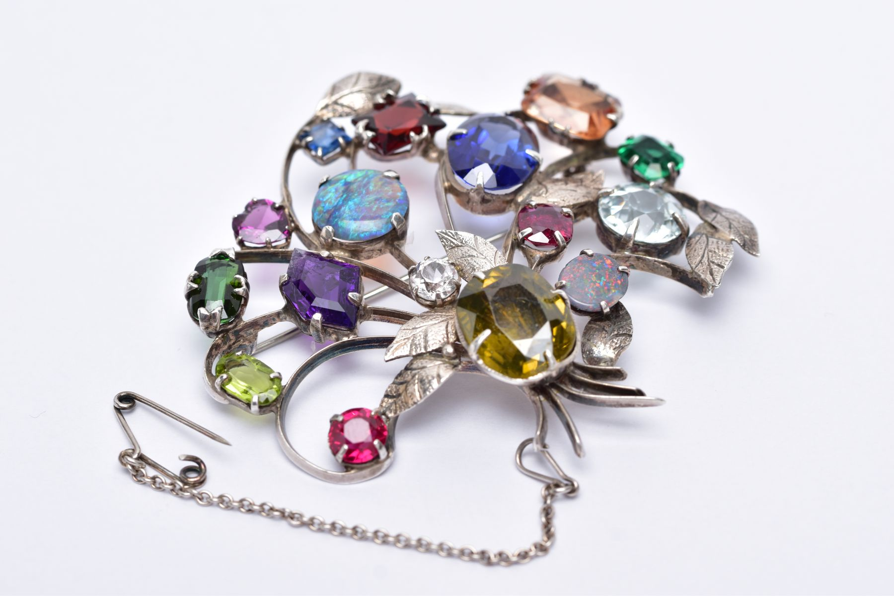 A WHITE METAL FLORAL SPRAY, GEM SET BROOCH, floral spray set with a variety of multi cut gemstones - Image 5 of 5