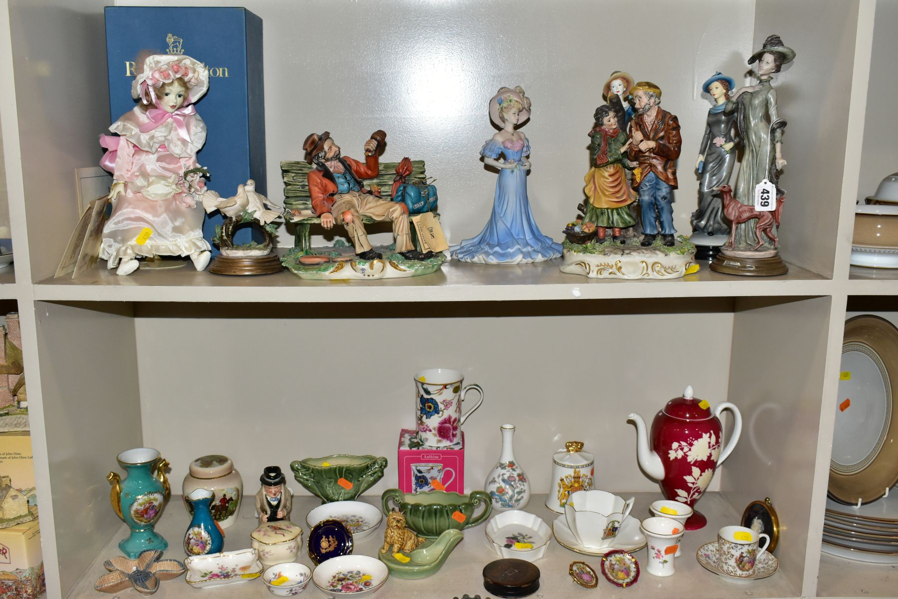A GROUP OF CERAMIC FIGURES AND ORNAMENTS, including Capo Di Monte tramp on a bench, elderly