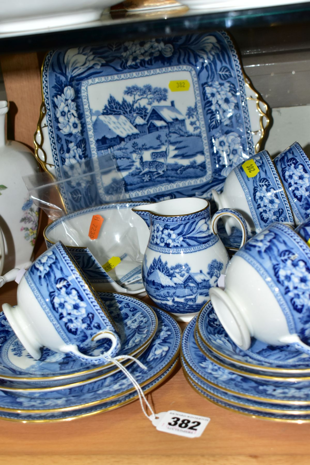 AN EARLY 20TH CENTURY WEDGWOOD BONE CHINA BLUE AND WHITE FALLOW DEER PATTERN PART TEA SET, brown